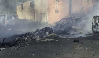 In this image provided by the Town of Carlstadt smoke rises after a jet crashed into a building near Teterboro Airport in Carlstadt, N.J., Monday, May 15, 2017. (Joe Orlando/Town of Carlstadt via AP)