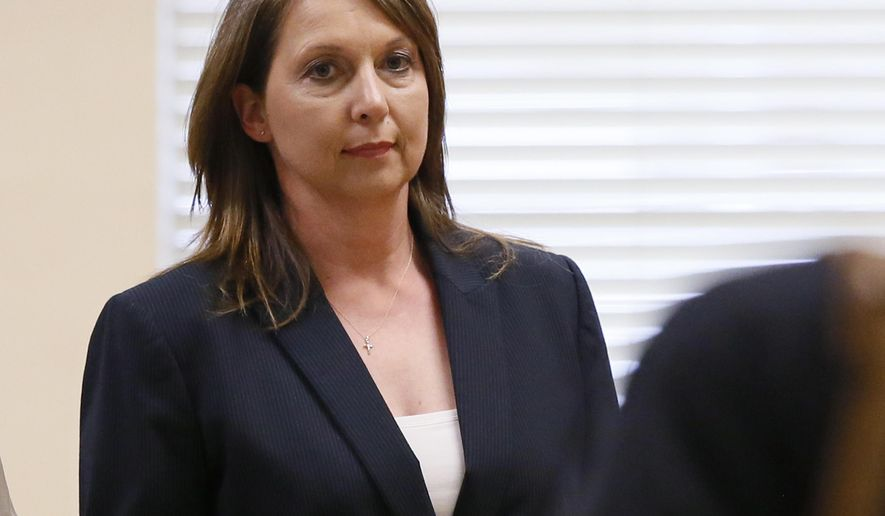 Betty Shelby leaves the courtroom following testimony in her trial in Tulsa, Okla., Friday, May 12, 2017. Shelby is charged with manslaughter in the shooting of Terence Crutcher, an unarmed black man. (AP Photo/Sue Ogrocki)