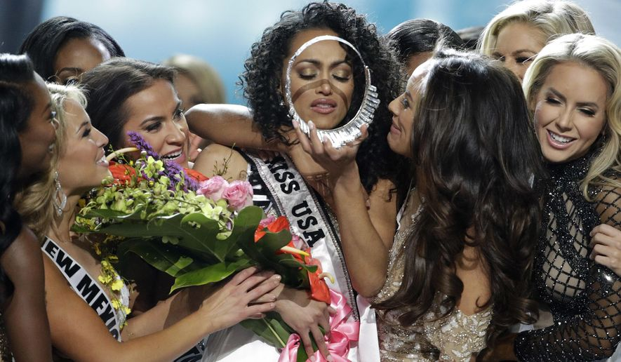 Miss District of Columbia USA Kara McCullough, center, reacts with fellow contestants after she was crowned the new Miss USA during the Miss USA contest Sunday, May 14, 2017, in Las Vegas. (AP Photo/John Locher)
