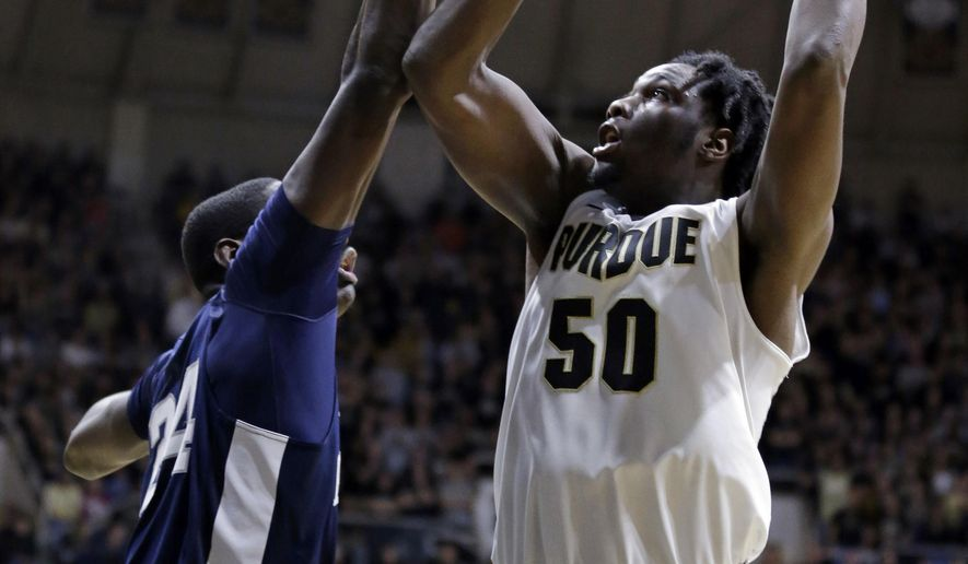 FILE - In this Jan. 21, 2017, file photo, Purdue forward Caleb Swanigan (50) shoots over Penn State forward Mike Watkins (24) in the second half of an NCAA college basketball game in West Lafayette, Ind. Indiana native and Big Ten player of the year Caleb Swanigan has declared for the NBA draft. On Monday, May 15, 2017, he will work out in front of his home state Indiana Pacers. The question, of course, is whether he will sign with an agent.  (AP Photo/Michael Conroy, File)