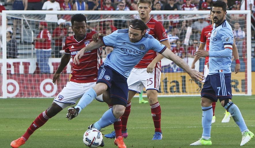 FC Dallas midfielder Kellyn Acosta, left, wrestles with New York City FC midfielder Thomas McNamara (15) for the ball during the first half of an MLS soccer game in Frisco, Texas, Sunday, May 14, 2017. (Steve Hamm/The Dallas Morning News via AP)