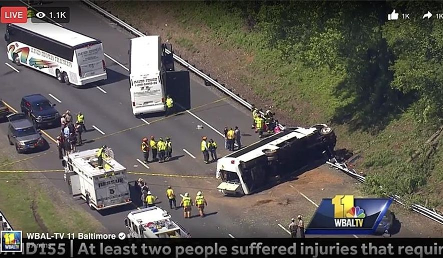 In this image made from video and provided by WBAL-TV, authorities investigate an overturned bus on Interstate 95, Monday, May 15, 2017 near Havre de Grace, Md. Cpl. Tyler Allaband of the Maryland State Police said by telephone that the bus overturned in the southbound lanes of the highway on Monday near the exit for Havre de Grace. He says several people are injured, but he did not know how many people or the extent of their injuries. (WBAL-TV via AP)