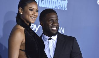 FILE - In this Dec. 11, 2016, file photo, Kevin Hart, right, and Eniko Parrish arrive at the 22nd annual Critics' Choice Awards at the Barker Hangar in Santa Monica, Calif. Hart and Parrish announced on May 14, 2017, that they are expecting their first child together. (Photo by Jordan Strauss/Invision/AP, File)