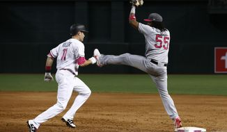 Pittsburgh Pirates' Josh Bell (55) makes a catch at first base to get Arizona Diamondbacks' A.J. Pollock (11) out during the sixth inning of a baseball game Sunday, May 14, 2017, in Phoenix. The Pirates defeated the Diamondbacks 6-4. (AP Photo/Ross D. Franklin)