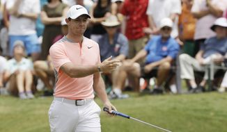 Rory McIlroy of Northern Ireland, reacts to his putt on the second green, during the final round of The Players Championship golf tournament Sunday, May 14, 2017, in Ponte Vedra Beach, Fla. (AP Photo/Chris O'Meara)
