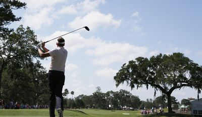 Ian Poulter, of England, hits from the ninth tee during the final round of The Players Championship golf tournament Sunday, May 14, 2017, in Ponte Vedra Beach, Fla. (AP Photo/Lynne Sladky)