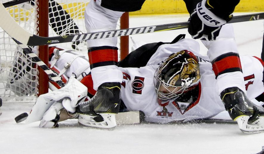 Ottawa Senators goalie Craig Anderson (41) knocks the puck out of the crease against the Pittsburgh Penguins during the second period of Game 2 of the Eastern Conference final in the NHL hockey Stanley Cup playoffs, Monday, May 15, 2017, in Pittsburgh. (AP Photo/Gene J.Puskar)