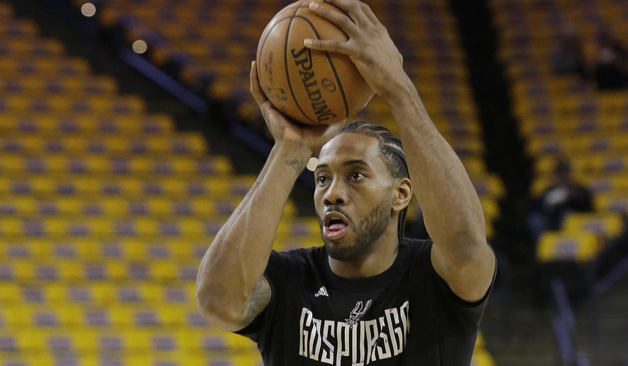 San Antonio Spurs forward Kawhi Leonard warms up before Game 1 of the NBA basketball Western Conference finals against the Golden State Warriors in Oakland, Calif., Sunday, May 14, 2017. (AP Photo/Jeff Chiu)