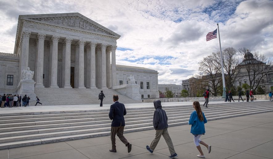 """FILE - In this April 7, 2017 file photo, visitors arrive at the Supreme Court in Washington. The Supreme Court on Monday, May 15, 2017, rejected an appeal to reinstate North Carolina's voter identification law that a lower court said targeted African-Americans """"with almost surgical precision.""""  (AP Photo/J. Scott Applewhite, File)"""