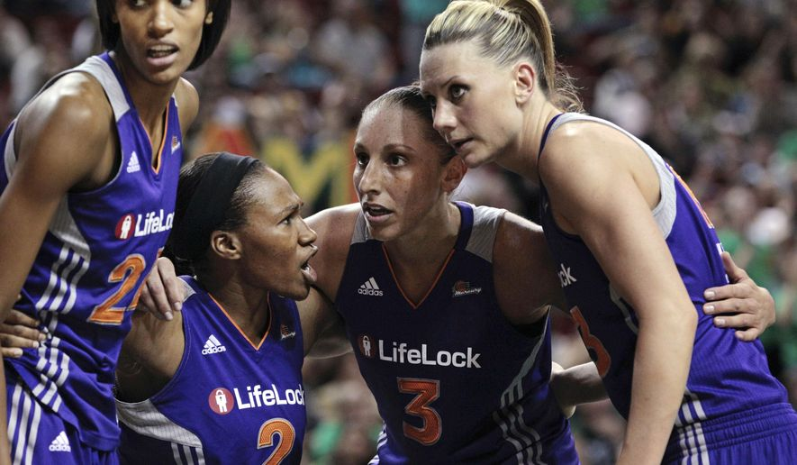 FILE - From left, in this Sept. 15, 2011, file photo, Phoenix Mercury's DeWanna Bonner, Temeka Johnson, Diana Taurasi and Penny Taylor huddle during the first half of Game 1 of a first-round WNBA playoff basketball series against the Seattle Storm, in Seattle. Diana Taurasi has married former Phoenix Mercury teammate Penny Taylor, then played in the team's season opener less than 24 hours later. The 34-year-old Taurasi has played for the Mercury since 2004, helping the team win three titles. She also helped the U.S. win four consecutive Olympic gold medals. The couple married Saturday, May 13, 2017. (AP Photo/Elaine Thompson, File)