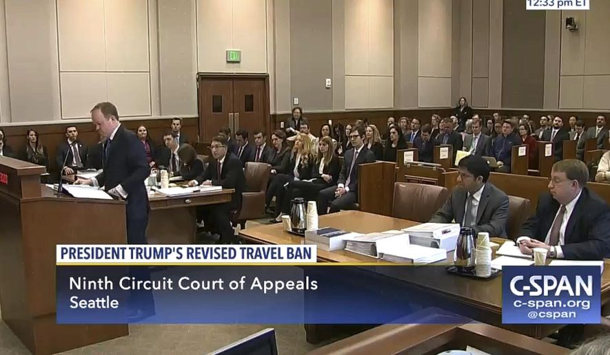 In this image made from a C-SPAN video, Acting Solicitor General Jeffrey Wall, standing at left, presents his arguments during a 9th Circuit Court of Appeals panel in Seattle, Monday, May 15, 2017. A three-judge panel of the 9th US Circuit Court of Appeals is hearing arguments over Hawaii's lawsuit challenging President Donald Trump's travel ban, which would suspend the nation's refugee program and temporarily bar new visas for citizens of Iran, Libya, Somalia, Sudan, Syria and Yemen. (CSPAN via AP, Pool)