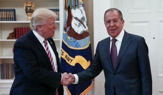 This handout photo released by the Russian Ministry of Foreign Affairs, shows President Donald Trump meeting with Russian Foreign Minister Sergey Lavrov in the Oval Office of the White House in Washington, Wednesday, May 10, 2017. (Russian Foreign Ministry via AP) ** FILE **