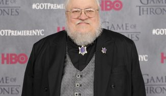 """FILE - In this March 18, 2014 file photo, author and co-executive producer George R. R. Martin attends the """"Game of Thrones"""" fourth season premiere in New York. HBO's """"Game of Thrones"""" is in its home stretch. But the game isn't over for its creator, Martin, who is in the thick of planning as many as five new """"Game of Thrones""""-related series for the network. Posting on his website, Martin specified that each concept under development is for a prequel, not a sequel. (Photo by Evan Agostini/Invision/AP, File)"""