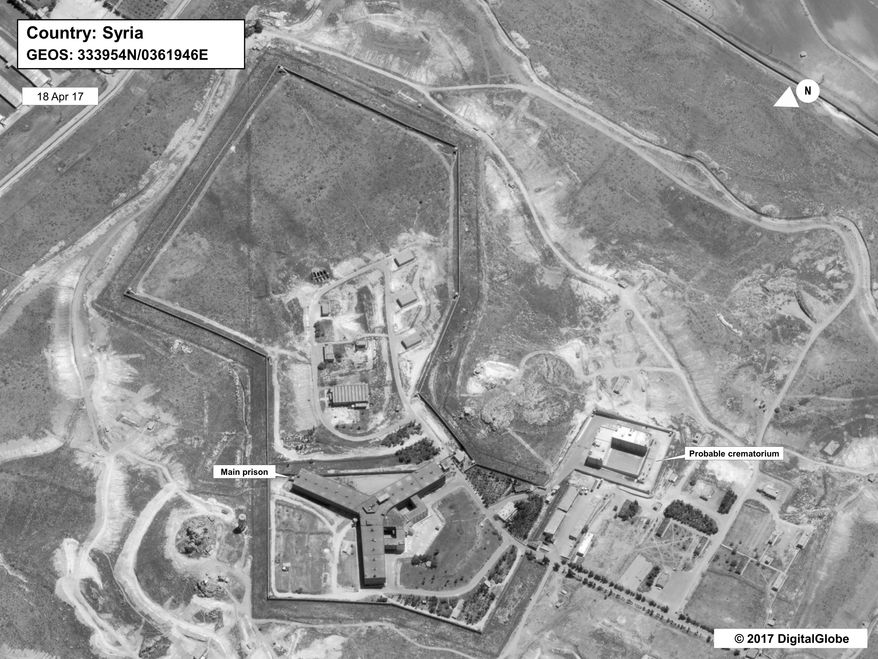 This image provided by the State Department and DigitalGlobe, taken April 18, 2017, a satellite image of what the State Department described as a building in a prison complex in Syria that was modified to support a crematorium. The Trump administration accused the Syrian government of carrying out mass killings of thousands of prisoners and burning the dead bodies in a large crematorium outside the capital. It also stepped up criticism of Iran and Russia for supporting the Syrian government. (State Department/DigitalGlobe via AP)