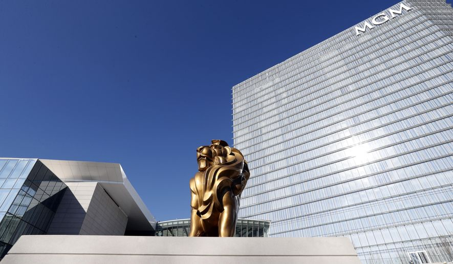 The MGM lion is seen in front of the 23-story hotel during a preview tour of the MGM National Harbor, Friday, Dec. 2, 2016 in Oxon Hill, Md. The $1.4 billion National Harbor casino and resort, just outside the nation's capital, is scheduled to open this week. (AP Photo/Alex Brandon)