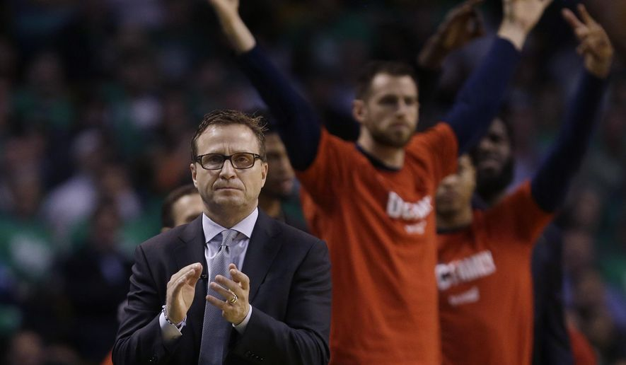 Washington Wizards head coach Scott Brooks, left, applauds from the sideline during the second quarter of Game 7 of a second-round NBA basketball playoff series against the Boston Celtics, Monday, May 15, 2017, in Boston. (AP Photo/Charles Krupa)