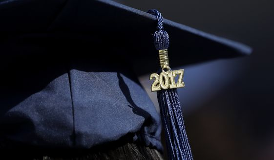 A graduate wears her cap ahead of the Fairleigh Dickinson University commencement ceremony, Tuesday, May 16, 2017, at MetLife Stadium in East Rutherford, N.J. (AP Photo/Julio Cortez) ** FILE **