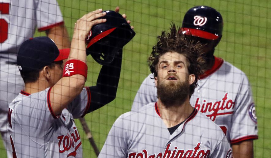 Washington Nationals' Bryce Harper (34) returns to the dugout after hitting a two-run home run off Pittsburgh Pirates relief pitcher Wade LeBlanc in the ninth inning of a baseball game in Pittsburgh, Tuesday, May 16, 2017. The Nationals won 8-4. (AP Photo/Gene J. Puskar)