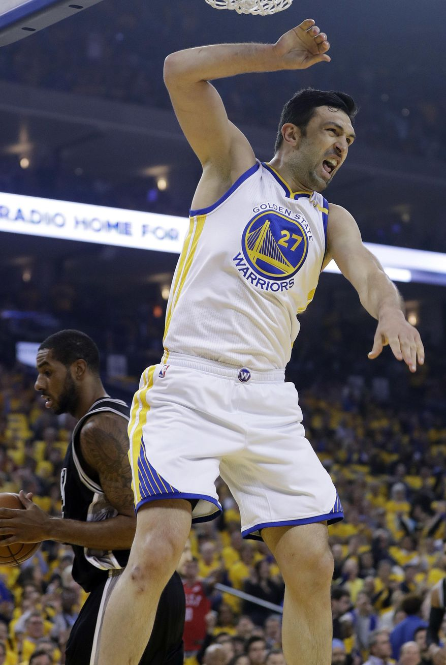 Golden State Warriors' Zaza Pachulia (27) celebrates as he dunks against the San Antonio Spurs during the first half of Game 2 of the NBA basketball Western Conference finals, Tuesday, May 16, 2017, in Oakland, Calif. (AP Photo/Marcio Jose Sanchez)