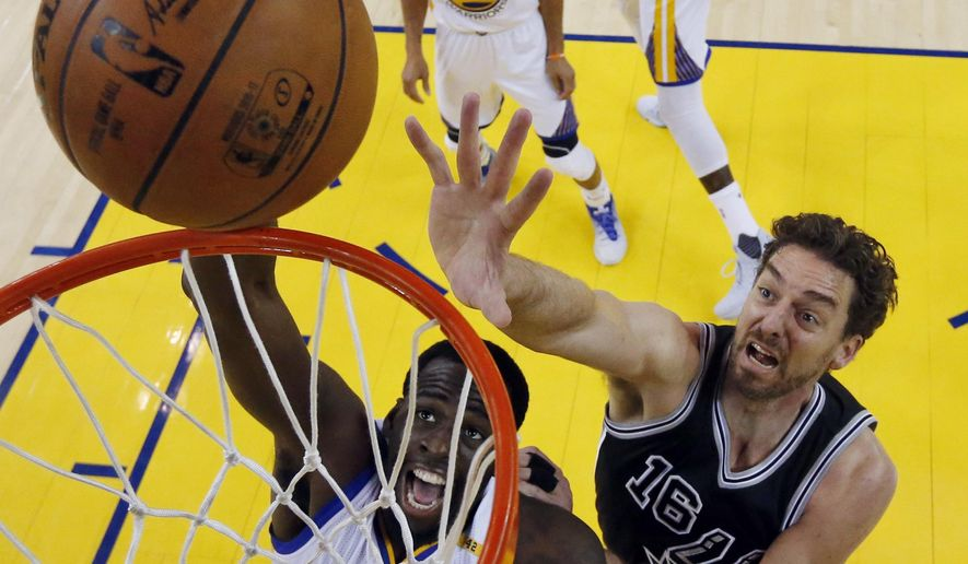 Golden State Warriors' Draymond Green, bottom left, works for a rebound against San Antonio Spurs' Pau Gasol (16) during the first half of Game 2 of the NBA basketball Western Conference finals, Tuesday, May 16, 2017, in Oakland, Calif. (AP Photo/Marcio Jose Sanchez)