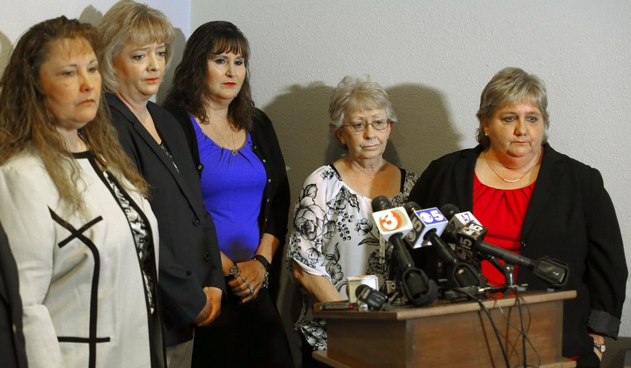 FILE - This May 7, 2014 file photo shows, from left, Michelle Parker, Tracey Everitt, Jana Leineweber, Janet Sabol, and Deborah Harper at a news conference in Phoenix. All were senior Arizona child welfare employees who were fired in April, 2014 for their role in the closure of more than 6,500 Arizona child abuse and neglect cases. The Arizona Supreme Court announced Monday, May 15, 2017, it is declining to review a decision upholding the firings of the five, who said they were made scapegoats for the scandal involving the state's former Child Protective Services agency. (AP Photo/Ross D. Franklin, File)