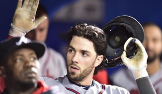 Atlanta Braves shortstop Dansby Swanson is congratulated in the dugout after hitting a solo home run against the Toronto Blue Jays during seventh inning interleague baseball action in Toronto, Tuesday, May 16, 2017. (Frank Gunn/The Canadian Press via AP)