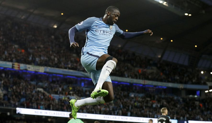 Manchester City's Yaya Toure celebrates scoring against West Bromwich Albion during the English Premier League soccer match at the Etihad Stadium, Manchester, England, Tuesday May 16, 2017. (Martin Rickett/PA via AP)