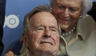 In this June 12, 2012, file photo, former President George H.W. Bush and his wife, Barbara, arrive for the premiere of HBO's new documentary about his life in Kennebunkport, Maine. Bush and wife, Barbara, are back in Maine. (AP Photo/Charles Krupa, File) **FILE**