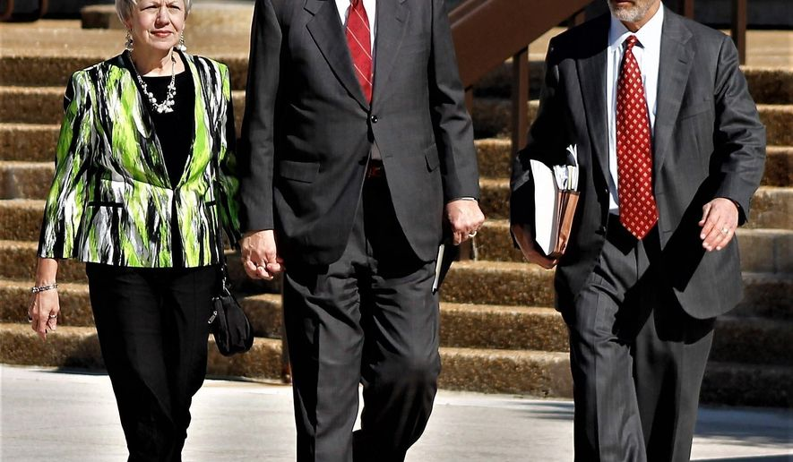 Former North Carolina state Sen. Fletcher Hartsell, flanked by his wife, Tana, and defense attorney Rock Glaser, are shown leaving the federal courthouse on Tuesday, May 16, 2017. Hartsell was sentenced to eight months in prison for misusing more than $200,000 in campaign funds for personal use. (AP Photo/Skip Foreman)