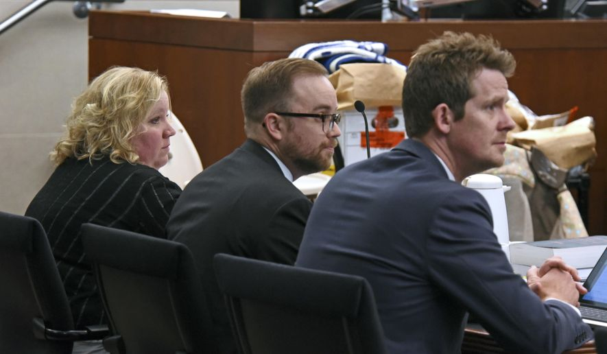 In this Friday, May 5, 2017 photo, Tisha Morley, left, sits with her attorneys, Jason Widdison, center, and Logan Bushell, right, during her trial in Ogden, Utah. Jurors on Tuesday, May 26, 2017, began deliberations on whether they believe the assertion from prosecutors that Morley, a northern Utah daycare owner, killed an 8-month-old boy by slamming his head on a changing table in frustration. (Sarah Welliver/Standard-Examiner via AP)