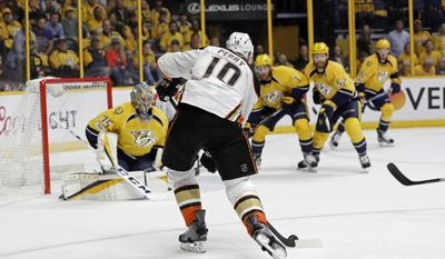 Anaheim Ducks right wing Corey Perry (10) lines up to shoot against Nashville Predators goalie Pekka Rinne (35), of Finland, during the first period in Game 3 of the Western Conference final in the NHL hockey Stanley Cup playoffs Tuesday, May 16, 2017, in Nashville, Tenn. (AP Photo/Mark Humphrey)