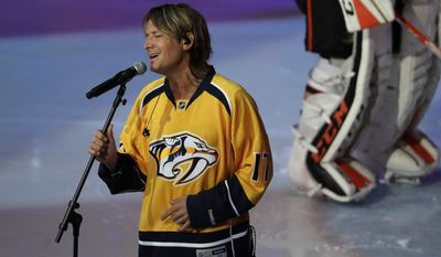 Country Music recording artist Keith Urban sings the National Anthem before Game 3 of the NHL hockey Western Conference championship series between the Nashville Predators and the St. Louis Blues Tuesday, May 16, 2017, in Nashville, Tenn. (AP Photo/Mark Humphrey)