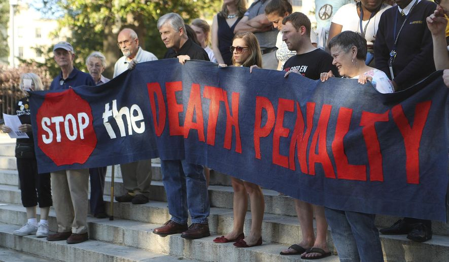 May 16, 2017, Atlanta: Death penalty opponents protest the planned execution of J.W. Ledford for the 1992 murder of his elderly neighbor at the State Capitol on Tuesday, May 16, 2017, in Atlanta. The execution would be Georgia's first of 2017. (Curtis Compton/Atlanta Journal-Constitution via AP)