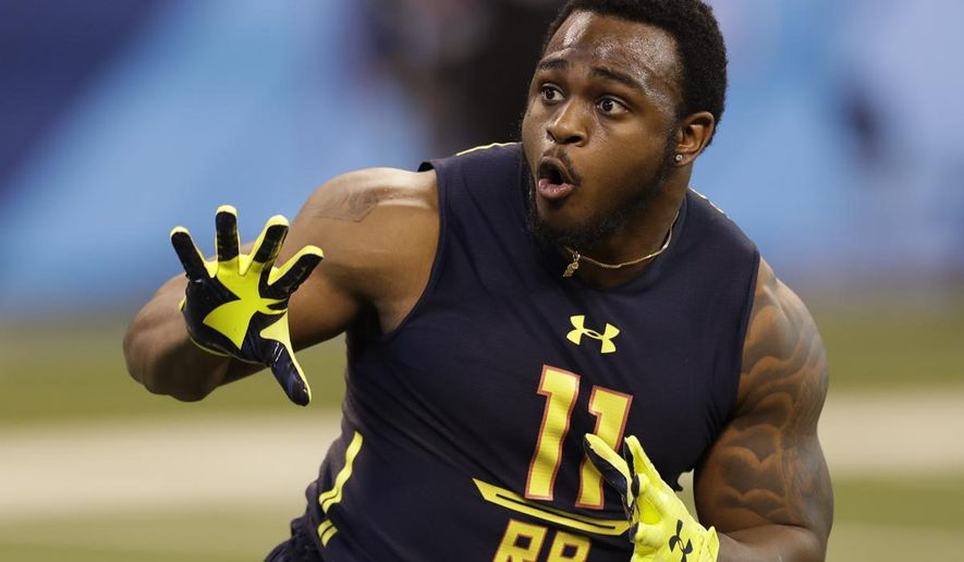 "FILE - In this March 3, 2017, file photo, Coastal Carolina running back De'Angelo Henderson runs a drill at the NFL football scouting combine in Indianapolis. The first thing rookie running back De'Angelo ""Hop"" Henderson inquired about when the Denver Broncos drafted him was whether No. 33 was available. Unlike many NFL rookies who have superstitious reasons for seeking certain jersey numbers _ and often paying a veteran who already owns it cold, hard cash to get it _ Henderson wanted the number to honor a friend. ""My fraternity brother Anthony Frye died March 2, 2016,"" Henderson explained. ""He wore no. 33 when he played at Coastal. He was one of my closest friends."" (AP Photo/David J. Phillip, File)"