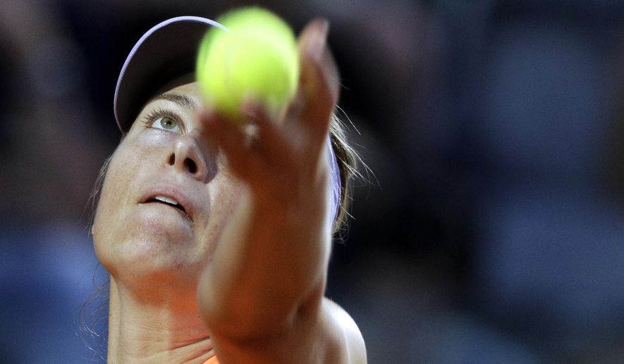 Maria Sharapova, of Russia, serves the ball to Mirjana Lucic-Baroni, of Croatia, during the Italian Open tennis tournament, in Rome, Tuesday, May 16, 2017. (AP Photo/Andrew Medichini)
