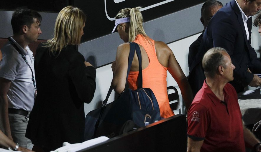 Maria Sharapova of Russia leaves the field of play after reporting an injury during her match against Mirjana Lucic-Baroni of Croatia, at the Italian Open tennis tournament, in Rome, Tuesday, May 16, 2017. Maria Sharapova has retired from her Italian Open match against Marjana Lucic-Baroni citing an apparent left thigh injury. Sharapova was leading 4-6, 6-3, 2-1 when she called it quits after Lucic-Baroni held serve. (AP Photo/Andrew Medichini)