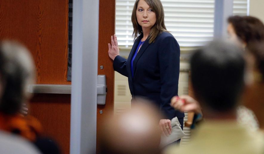 Tulsa Police Officer Betty Shelby enters the courtroom Monday, May 15, 2017, in Tulsa, Okla., for her manslaughter trial in the shooting of Terence Crutcher. Shelby said Monday that a training video of an officer being fatally shot during a traffic stop ran through her mind last September when she encountered 40-year-old Crutcher, whose SUV had stalled in the middle of a street. (Mike Simons/Tulsa World via AP)