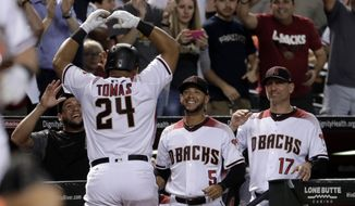 Arizona Diamondbacks Yasmany Tomas (24) celebrates after hitting a two RBI home run against the New York Mets during the eighth inning of a baseball game, Monday, May 15, 2017, in Phoenix. (AP Photo/Matt York)