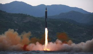 "FILE - This May 14, 2017, file photo distributed by the North Korean government shows the ""Hwasong-12,"" a new type of ballistic missile at an undisclosed location in North Korea. North Korea on Monday, May 15, 2017 boasted it successfully launched a new type of ""medium long-range"" ballistic rocket that can carry a heavy nuclear warhead, an escalation of its nuclear program. Independent journalists were not given access to cover the event depicted in this photo. (Korean Central News Agency/Korea News Service via AP, File)"