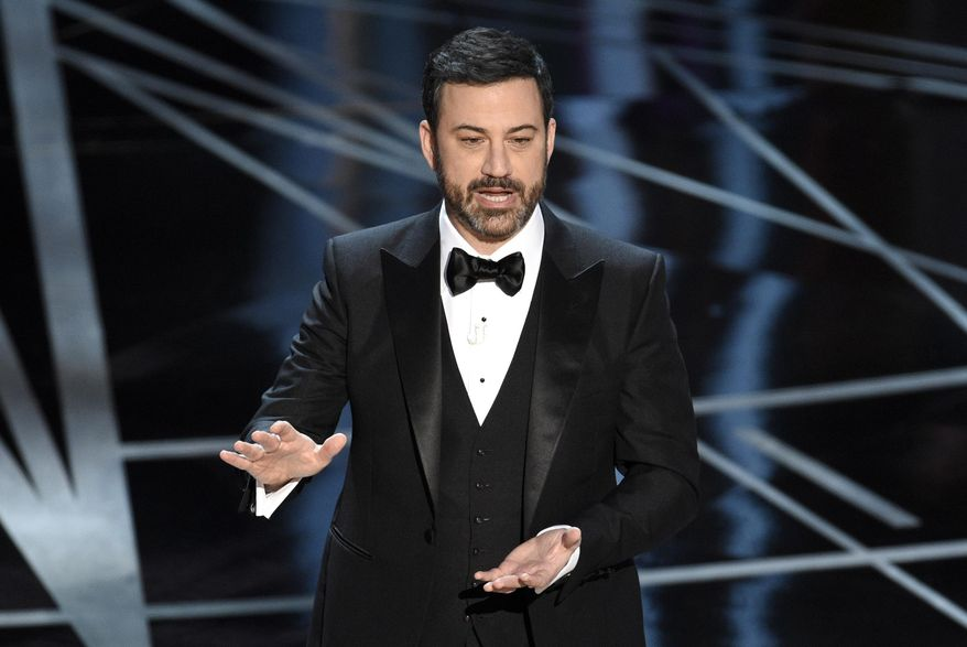 FILE - In this Feb. 26, 2017 file photo, host Jimmy Kimmel appears at the Oscars in Los Angeles. The Academy of Motion Picture Arts and Sciences on Tuesday, May 16, 2017, said Kimmel will return for the 90th Oscars on March 4, 2018. (Photo by Chris Pizzello/Invision/AP, File)