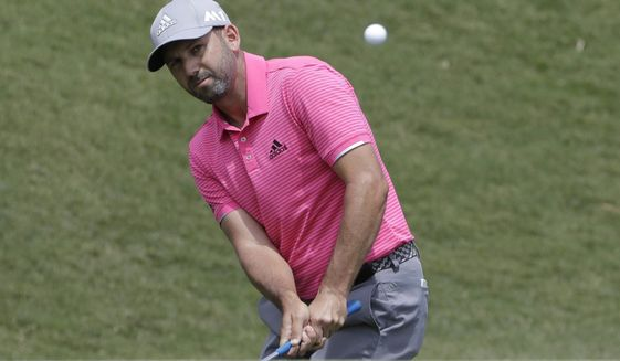 Sergio Garcia, of Spain, chips onto the second green during the final round of The Players Championship golf tournament Sunday, May 14, 2017, in Ponte Vedra Beach, Fla. (AP Photo/Chris O'Meara)