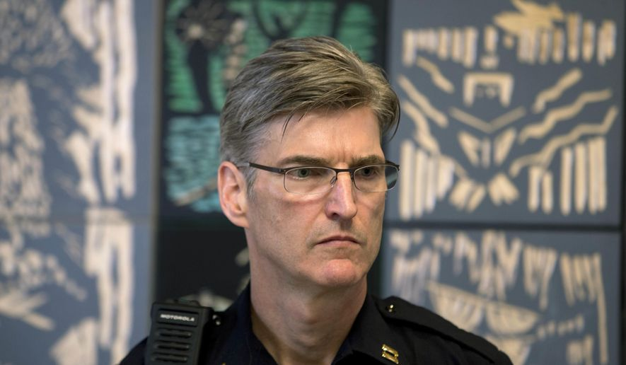 FILE- This June 27, 2016 file photo shows Portland Police Capt. Mike Marshman at a ceremony before he is announced as the new Police Chief in Portland, Ore. Portland has begun the search for a new police chief--a search that comes as the bureau is struggling with a staffing shortage, its controversial handling of large-scale protests, a recent officer-involved fatal shooting of a black teenager and the adoption of policy, training and accountability reforms required under a settlement agreement with the U.S. Department of Justice. (Beth Nakamura/The Oregonian/Oregon live via AP, file)/The Oregonian via AP)
