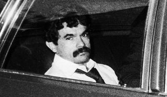 In this July 25, 1981 file photo, Puerto Rican nationalist Jose Lopez Rivera is driven to jail after his trial where he was convicted of seditious conspiracy in Chicago. Lopez Rivera, a Puerto Rican nationalist who was the last of his group serving time for his role in a violent struggle for independence for the U.S. territory, will be released from prison on Wednesday, May 17, 2017, to the cheers of his supporters and the dismay of the victims of violence.  (Chicago Tribune via AP, File)