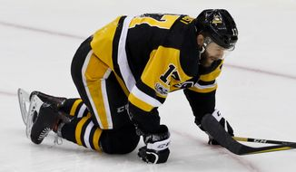 Pittsburgh Penguins' Bryan Rust gets up from the ice slowly after being injured in a collision during the first period of Game 2 of the Eastern Conference final against the Ottawa Senators in the NHL Stanley Cup hockey playoffs in Pittsburgh, Tuesday, May 16, 2017. Rust did not return to action in the game. (AP Photo/Gene J. Puskar)