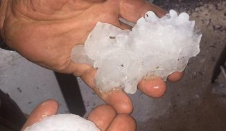 This photo provided by Stacey Valdez shows hail Valdez took in Sayre, Okla., Tuesday, May 16, 2017. Also, a tornado struck a rural area in western Oklahoma, leaving damage in its wake but no immediate reports of injuries. The storm struck a subdivision Tuesday just south of Elk City, Okla., about 110 miles west of Oklahoma City. (Stacey Valdez via AP)