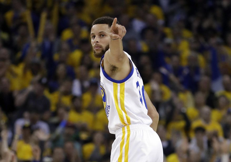 Golden State Warriors' Stephen Curry signals after scoring against the San Antonio Spurs during the first half of Game 2 of the NBA basketball Western Conference finals, Tuesday, May 16, 2017, in Oakland, Calif. (AP Photo/Marcio Jose Sanchez)
