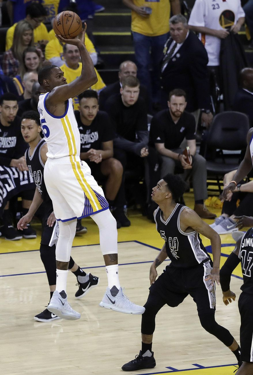 Golden State Warriors' Kevin Durant shoots over San Antonio Spurs' Dejounte Murray, right, during the first half of Game 2 of the NBA basketball Western Conference finals, Tuesday, May 16, 2017, in Oakland, Calif. (AP Photo/Marcio Jose Sanchez)
