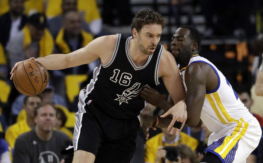 San Antonio Spurs' Pau Gasol (16) is defended by Golden State Warriors' Draymond Green during the first half of Game 2 of the NBA basketball Western Conference finals, Tuesday, May 16, 2017, in Oakland, Calif. (AP Photo/Marcio Jose Sanchez)