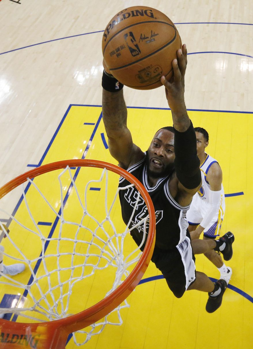San Antonio Spurs' Jonathon Simmons (17) dunks against the Golden State Warriors during the first half of Game 2 of the NBA basketball Western Conference finals, Tuesday, May 16, 2017, in Oakland, Calif. (AP Photo/Marcio Jose Sanchez)