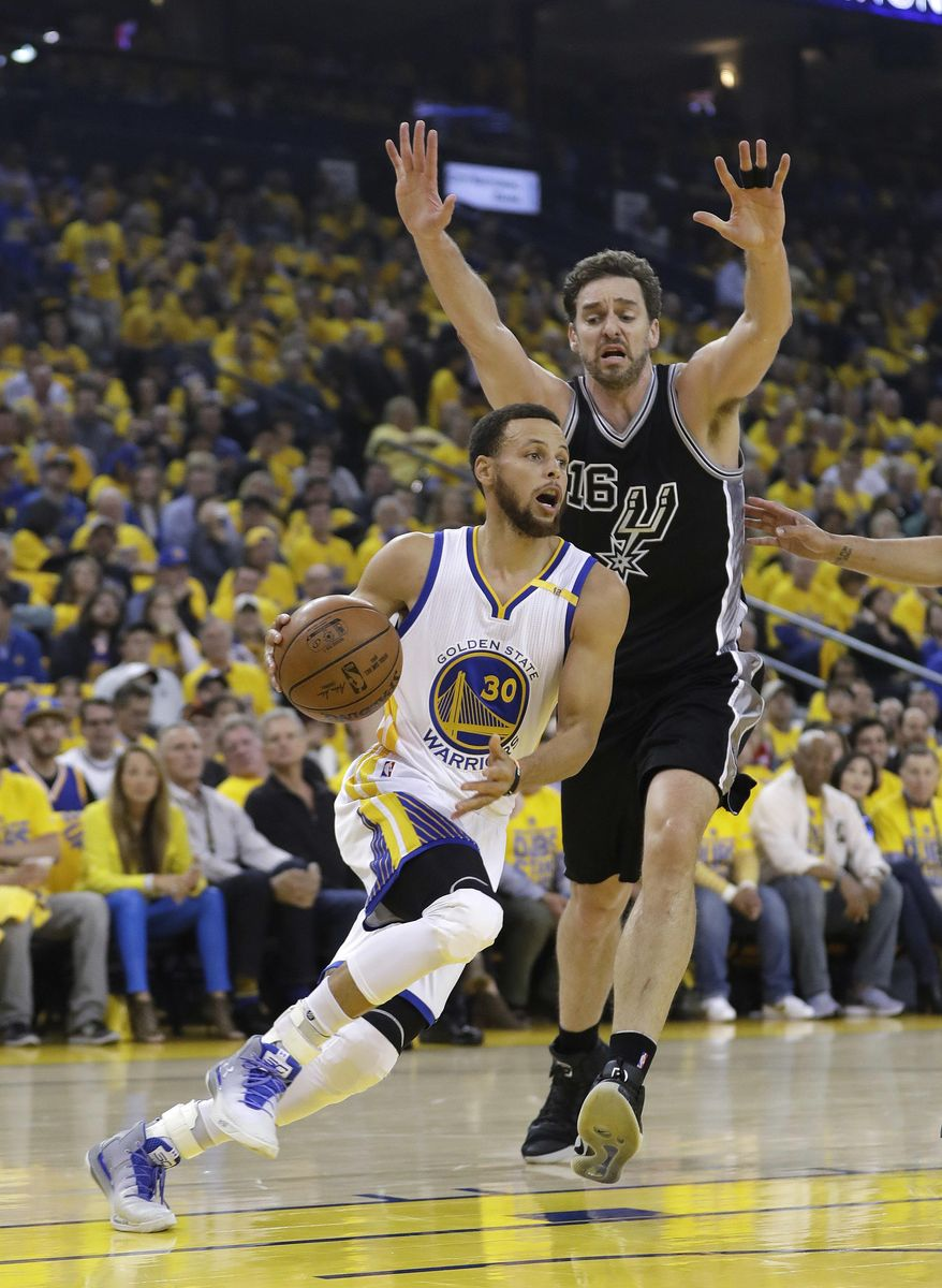 Golden State Warriors' Stephen Curry, left, dribbles past San Antonio Spurs' Pau Gasol during the first half of Game 2 of the NBA basketball Western Conference finals, Tuesday, May 16, 2017, in Oakland, Calif. (AP Photo/Marcio Jose Sanchez)